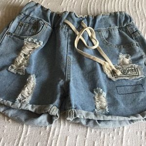 Distressed jean shorts.